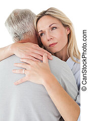Close up of mature couple embracing