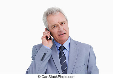 Close up of mature tradesman on his mobile phone