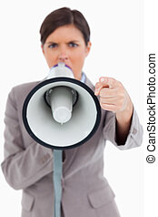 Close up of megaphone being used by angry entrepreneur