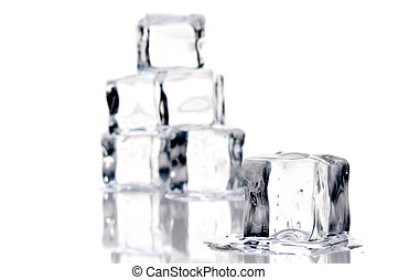 close up of melting ice cubes on a relective surface