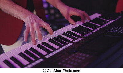 Close up of men hands playing on piano. Male hands playing piano view from above. Close up man playing a musical instrument. Male fingers piano play