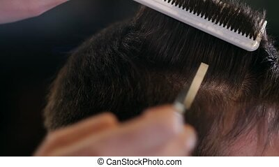 Close up of men's hair cutting scissors in a beauty salon....