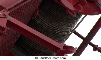 Close-up of metal cable crane winch. Special machines on the...
