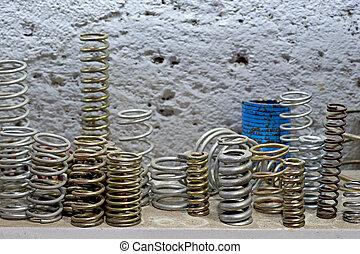 metal springs - close up of metal springs on shelf in ...
