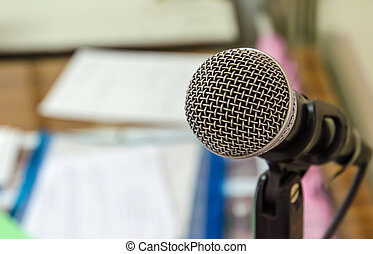 Close up of microphone in meeting room.