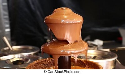 Close up of milk chocolate fountain for desserts - Close up...