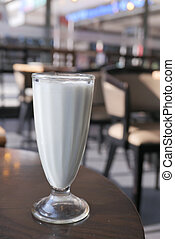 Close up of milk shake on cafe table.