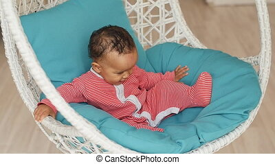 Close up of mixed race cute baby boy lying - Close up of...