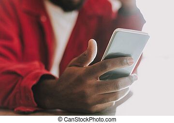 Close up of modern gadget in the hand of young man