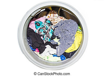 close up of modern washing machine loaded with clothes isolated on white background. full dirty , closeup. ashing window