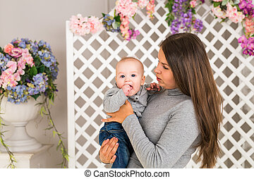 Close up of mother with baby in the room