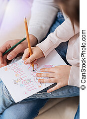 Close up of Mothers Day postcard being drawn by a girl