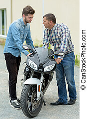 close up of motorbike lesson in progress