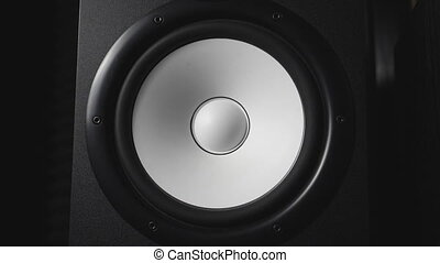 Close up of moving modern sub-woofer on recording studio....