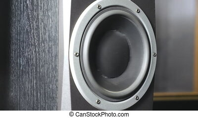Close up of moving sub-woofer on recording studio. Black...