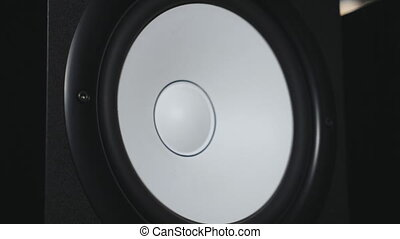 Close up of moving sub-woofer on recording studio. White...