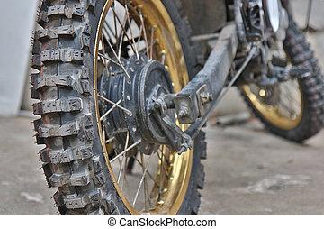 Close-up of muddy rear wheel