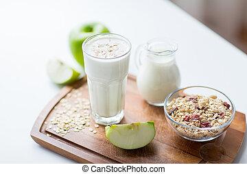 close up of muesli and yogurt on cutting board - food, ...