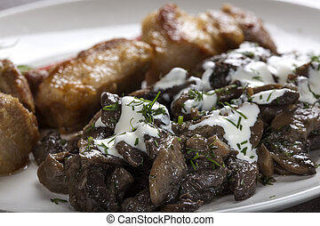 Close up of mushrooms and sour cream on plate