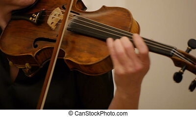 Close-up of musician playing violin