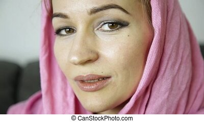 close-up of muslim girl in pink hijab drinks coffee -...