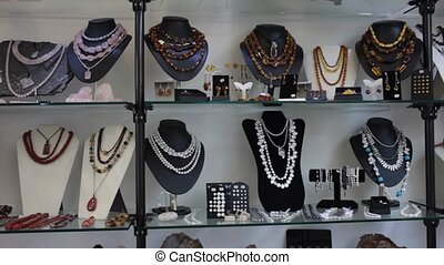Close up of natural stone bead necklaces in jewelry shop - ...