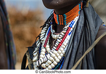 Close up of necklaces of Arbore tribe woman - Necklaces of a...