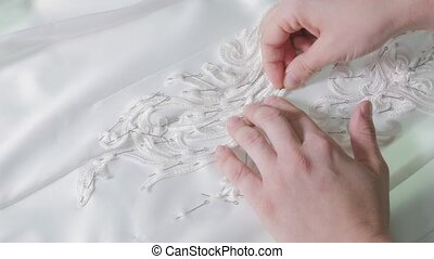 close-up of needle and thread, embroider pattern. Equipment...