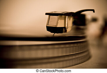 Close-up of needle on record player - Needle on record paper...