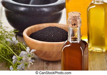 Close-up of nigella sativa oil. - Close-up of nigella sativa...