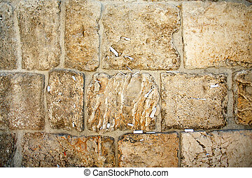 Close-up of notes to God in the Western Wall