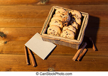 close up of oat cookies and card  on wooden table
