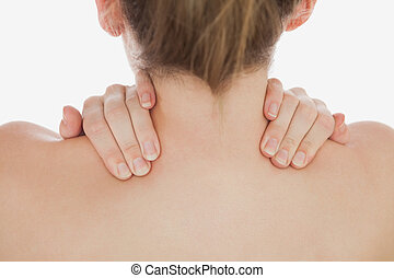 Close-up of of woman massaging neck
