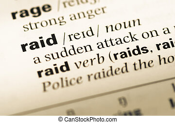 Close up of old English dictionary page with word raid