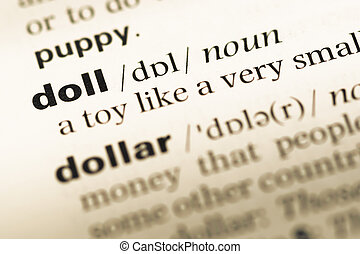 Close up of old English dictionary page with word doll