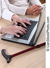 Close-up of old lady using laptop computer