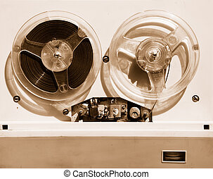 close-up of old tape recorder sepia horizontal