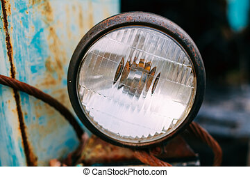 Close up of old vintage retro cars headlight