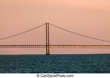 Close up of one of the towers of the Mackinac suspension bridge at sunset