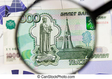 Close-up of one thousand rubles through a magnifying glass. Business background. Money research concept.