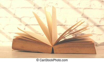 Close up of open books on a table