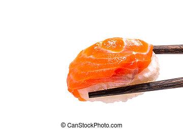 Close-up of Orange fresh salmon sushi nigiri in chopsticks isolated on white