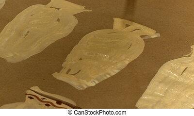 Close-up of original artist draws vases