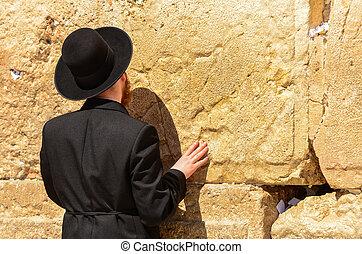 Close-up of Orthodox Jewish man praying at the Western Wall in Jerusalem, Israel