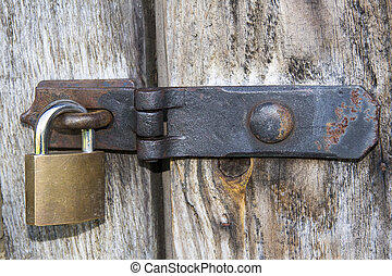 Close up of padlock and old metal hasp and staple on an old...