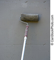 Close up of painting a concrete wall with roller