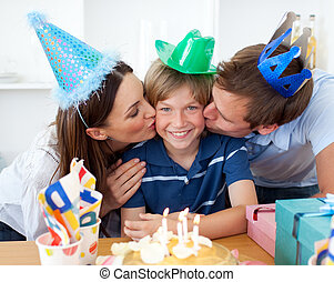Close-up of parents celebrating their son\'s birthday