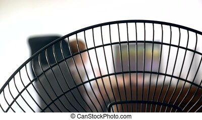 close-up of part of an office fan, on the background of a...