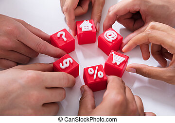 People Holding Red Cubic Blocks With Vivid Icons