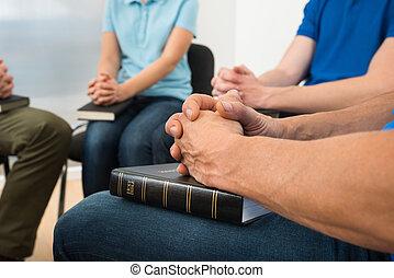 People Praying - Close-up Of People Praying With Holy Bible